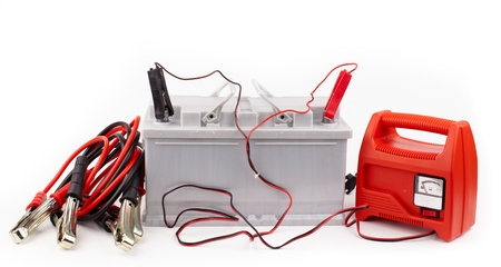 Car battery and jumper cables isolated on white Stock Photo - 18425839