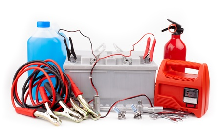 Car battery and jumper cables isolated on white photo