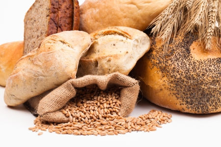 assortment of baked bread on white background