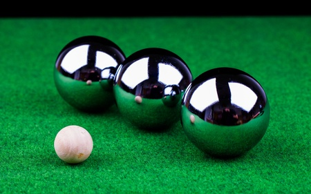 steel balls: steel balls on green surface Stock Photo