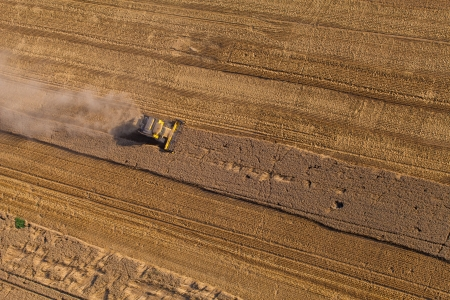 aerial view of harvest fields with combines photo