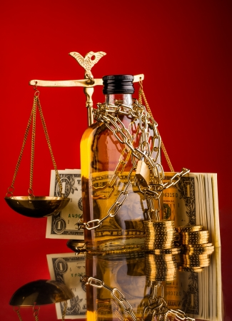 whisky bottle money and scales of justice photo