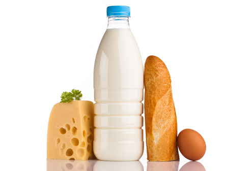 bread cheese and milk bottle isolated on white background photo