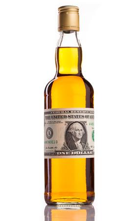 whisky bottle: whiskey bottle with money isolated on white