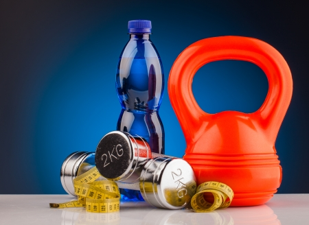 water power: fitness dumbbells and bottle of water  Stock Photo