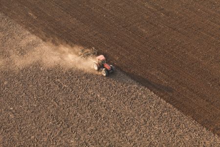 Aerial view of harvest fields with tractor Stok Fotoğraf - 24830935