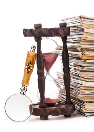 gazette: pile of newspapers and magnifying glass  Stock Photo