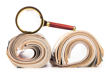 role of newspapers and magnifying glass  photo