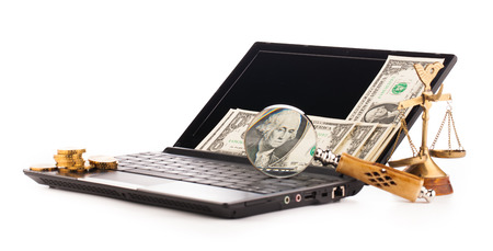 laptop computer keyboard money and magnifying glass  photo