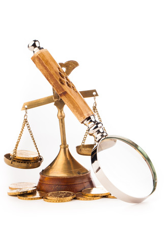 magnifying glass money and scales of justice Stock Photo