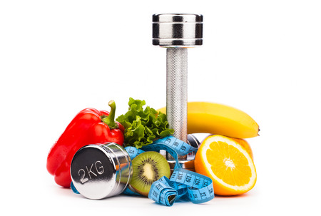 fitness dumbbells and fruits isolated on white Stock Photo