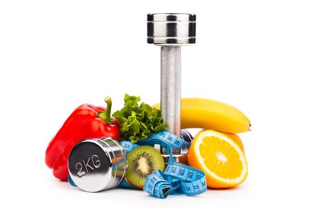 Fitness halters en fruit geïsoleerd op wit Stockfoto - 25157225