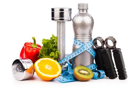 fitness halters en fruit geïsoleerd op wit Stockfoto