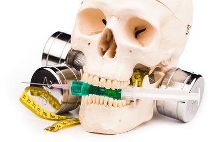 fitness human skull and syringe isolated on white photo