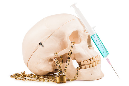 injectable:  human skull and syringe isolated on white