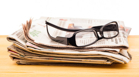 newspaper magazines on table photo