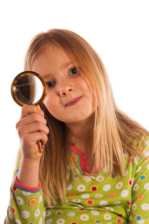 Little girl with magnifying glass photo