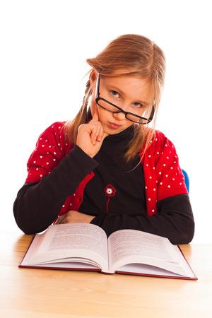 intelligently: Pretty  little girl reading a book