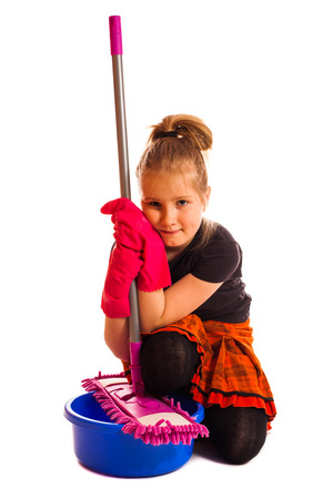 Pretty happy little girl with cleaning mop isolated  photo