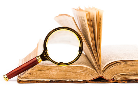 magnifying glass and old book photo