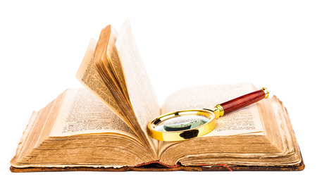 truthfulness: magnifying glass and old book