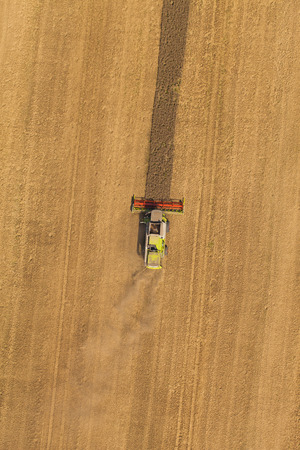 aerial view of combine on harvest field photo