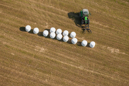 aerial view of tractor on harvest field photo