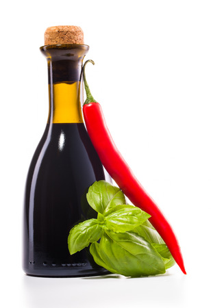 paprica: bottle of vinegar basile leaves and paprica