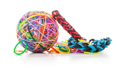 colorful wonder loom band rubber isolated on white photo