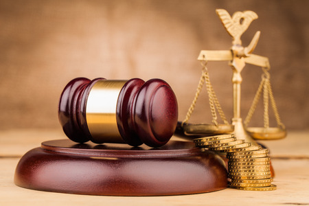 judge gavel  scales and money  on table Stock Photo