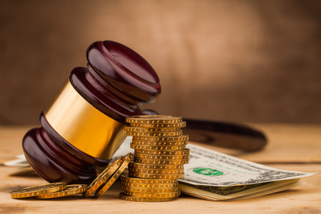judge gavel and dollar money on table
