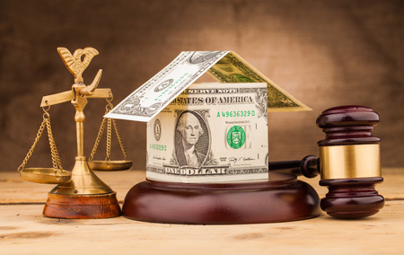 judge gavel  scales and money house on table