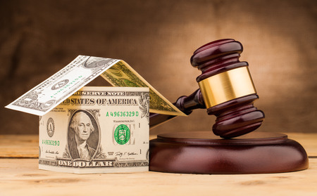 judge gavel and money house on table