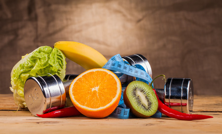 nutrition health: fitness equipment and healthy food