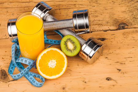 fitness equipment and healthy food fruits photo
