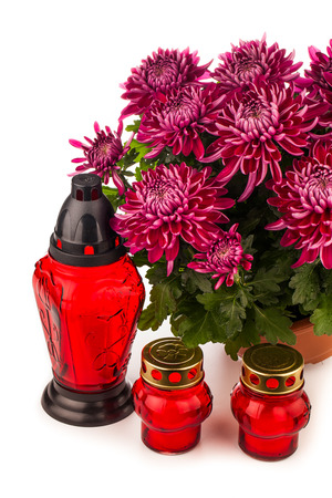 grave lantern and flovers isolated on white photo