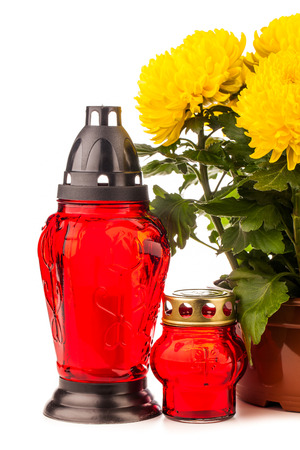 grave lantern with flowers isolated on white background photo