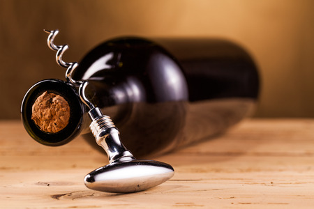 closed corks: wine bottle and corkscrew Stock Photo