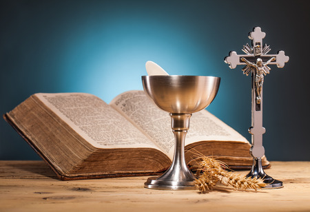 holy eucharist: christian holy communion  on wooden table Stock Photo