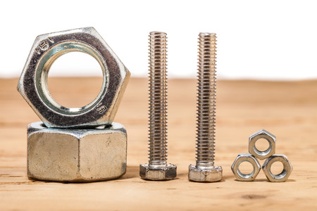 screws on wooden table photo