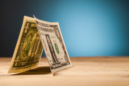 home finance: dollar money closeup on wooden table and blue background