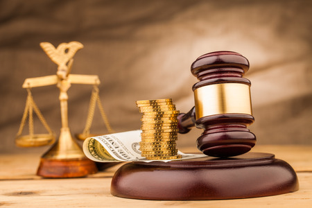 judge gavel with money on wooden table closeup Stock Photo