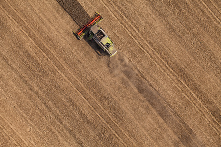 aerial views: aerial view of combine on harvest field in Poland Stock Photo