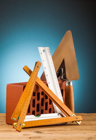 home builder: mason builder tools on wooden table Stock Photo