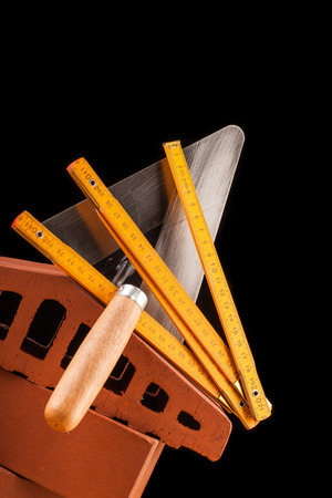 shrewd: builder  tools on black background and wooden table Stock Photo