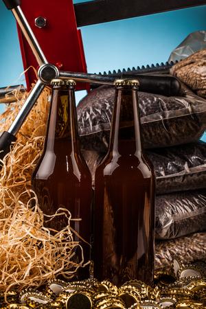 unbottled: bottles  of homemade beer  and bottle caps on table