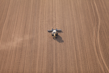 harvest: aerial view of harvest fields with tractor in Poland