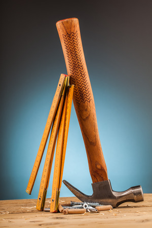 shrewd: hammer and wood mounting tools on wooden table