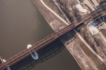 boxcar train: aerial view of railway bridgeon odra river in Wroclaw  Poland Stock Photo