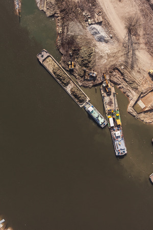 towed: aerial view of a river barge in wroclaw city in Poland